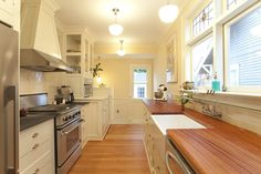 I like the sink, faucet, light colored cabinets and counter tops