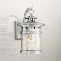 This chrome finish outdoor wall light offers a strong modern-industrial character in a traditional lantern design. 14 high x 8 wide. Extends 10 from the wall. Rectangular backplate is high x 4 wide x deep. Style # at Lamps Plus. Outdoor Wall Light Fixtures, Outdoor Wall Mounted Lighting, Exterior Light Fixtures, Exterior Wall Light, Outdoor Wall Lantern, Porch Lighting, Outdoor Wall Sconce, Exterior Lighting, Outdoor Walls