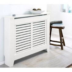 Discover the most stylish radiator cover ideas from the home decor experts at Domino, including built-in shelves, bookcases, and more! Learn how to hide your radiator in summertime. Decor, Storage Spaces, Home Remodeling, Radiators, Home, Interior, Home Staging, Home Decor, Radiator Cover