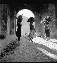 Image result for Pic of old Italian woman carrying a bundle of sticks on her back.