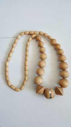 Finnish Aarikka necklace from the turn of the millennium. Material is lacquered wooden beads. Biggest bead has also a metal ring in the middle. Wooden Crosses, Wooden Necklace, Wooden Beads, Metal, Jewelry, Wood Crosses, Wood Necklace, Jewlery, Jewerly