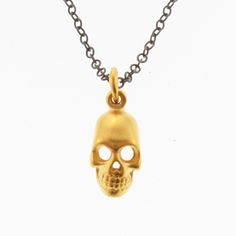 This Skull Charm Necklace is going to layer fabulously with the other skull necklaces ;) $100