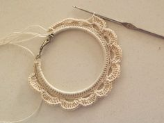 Tutorial and free patern on how to upcycle a pair of hoop earrings into a beautiful pair of crochet earrings.