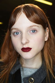 Heart-shaped, dark, red lips were teamed with slicked-back, curtained fringes at Mary Katrantzou.  Getty Images   - HarpersBAZAAR.co.uk