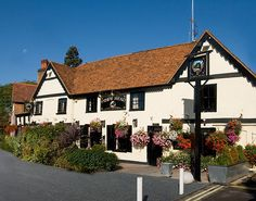 The Hinds Head, 15th-century building in pretty village of Bray, near Maidenhead. Heston Blumenthal's w/traditional seasonal cuisine and historic British dishes.
