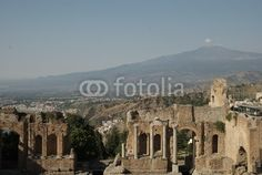 Taormina, greek theater with Etna's volcano background