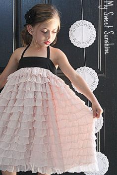 tiny dancer -- could use Patty Young's banded knit top pattern for bodice & add preruffled fabric for gathered skirt - I hate to admit that dear   daughter would probably love this