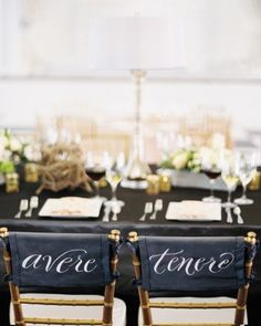 """Adorable! These newlyweds marked their spots at the head table with the Italian words for """"to have"""" and """"to hold"""""""