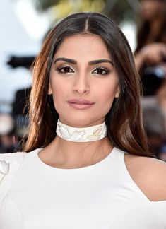 Sonam Kapoor Long Center Part - Sonam Kapoor went for simple elegance with this loose center-parted hairstyle at the Cannes premiere of 'From the Land of the Moon.'