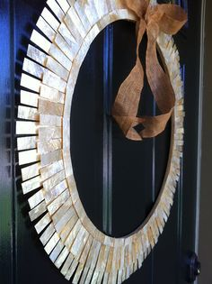 DIY shell wreath; this would be great for my oval bathroom mirrors that I wanted to put a frame on!