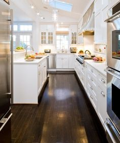 kitchen    dark floor, white cabinets