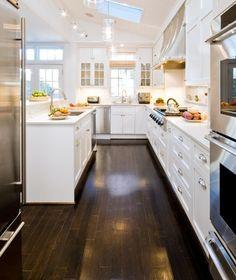 kitchen || dark floor, white cabinets