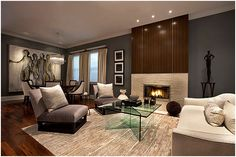 I LOVE this color palette, grey/cream/dk brown... also love the rug & oversized artwork on back wall.