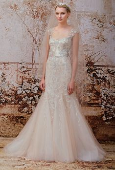 Brides.com: Monique Lhuillier - Fall 2014. Blush beaded tulle mermaid wedding dress with illusion cap sleeves, Monique Lhuillier