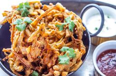 This spicy onion bhaji recipe is so easy to make and is the perfect vegan side dish for your next Indian. See more Indian vegetarian recipes at Tesco Real Food. Indian Food Recipes, Vegetarian Recipes, Ethnic Recipes, Vegan Meals, Onion Bhaji Recipes, Best Turmeric Supplement, Tesco Real Food, Great British Chefs, Vegan Side Dishes