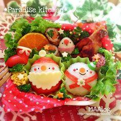 Santa Claus, snowman, and quail egg reindeer Christmas bento box