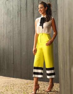 Neon yellow cropped flare pants with black and white stripes trim, pussybow neck tie sleeveless blouse Mode Outfits, Chic Outfits, Airport Outfits, Trendy Outfits, Look Fashion, Womens Fashion, Fashion Trends, Modest Fashion, Fashion Dresses