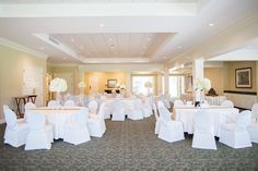 Hoover Country Club weddings. summer wedding. white linens. white hydrangeas, simple, gold table runners. Main Dining room from stage. ballroom. Birmingham, Alabama