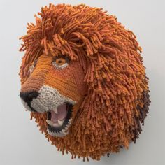 This crochet-knit sculpture of a life-sized lion's head is a witty, whimsical commentary on the sport of hunting and taxidermy's trophy exhibitionism. - by Nathan Vincent, via Fab Crochet Lion, Crochet Art, Crochet Animals, Crochet Dolls, Crochet Patterns, Crocheted Toys, Knit Art, Amigurumi Patterns, Crochet Taxidermy
