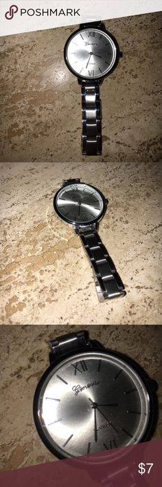 """Geneva Silver Watch Watch has a big face, stainless steel back. Watch is for people with a bigger wrist. 9"""" around wrist. It does have a cheaper feel to it. But it's cute to layer and wear with outfits. Accessories Watches"""