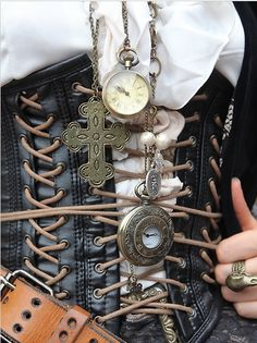 corset displaying multiple long necklaces and pocketwatches