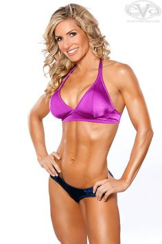 Gina's outlook on life and fitness keep her built and happy. See how this sizzling bodybuilder gets stage-ready while still enjoying things like rollerblading on the beach!