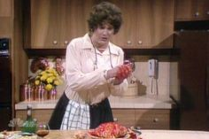 "Saturday Night Live: Dan Akroyd as Julia Child ""Oh no I seem to have cut myself."""