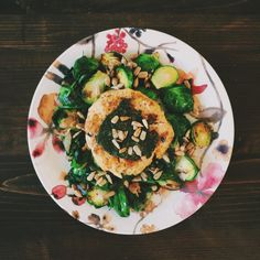 Sauteed kale, brussels sprouts, tuna cake with pesto and sunflower seeds