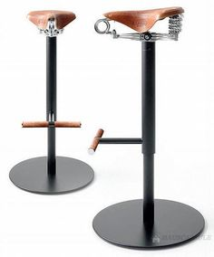 Bicycle-seat stools with foot rests.