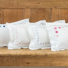 NEW baby pillowcase with hand embroidered border of mini stars. Also available in pink. 30cm x 40cm 100% cotton, 200...