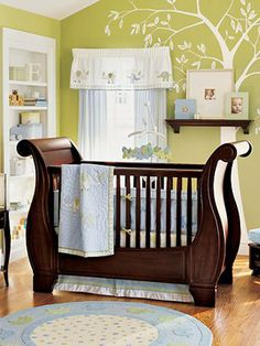 Nature-Themed Nurseries - I want to do a similar theme with Baby's nursery once we move. Green walls with tree decor, white furniture, and brown crib.