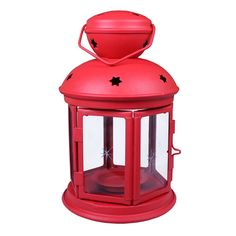 """23680 - Colonial Lantern Rustic Red - Wholesale. This lantern throws out a star pattern display from the top with it's multiple star pattern cutouts. Metal cup holds tea light or votive candle less than 1 3/4"""" diameter. Two panel door has a 3 1/2"""" x 3 1/2"""" opening."""
