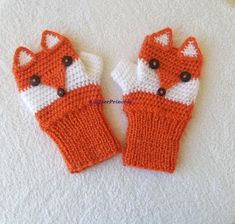 Crochet fox fingerless gloves in orange and white. This ones are in adult size, if you want child size please let me know. They will be