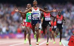 Mo Farah of Great Britain crosses the finish line to win gold ahead of Dejen Gebremeskel of Ethiopia and Thomas Pkemei Longosiwa of Kenya in the Men's 5000m Final on Day 15 of the London 2012 Olympic Games