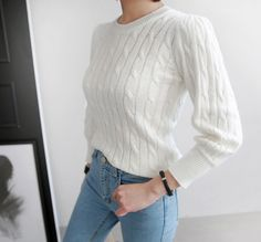 Adorably feminine, this Solid Tone Cable Knit Sweater features a lovely cable knit pattern, ribbed round neck, long sleeves with ribbed cuffs and hem with a figure-flattering fit. Grab your go-to pairs of skinny jeans and flats and you're good to go! #classic #ivory #knit