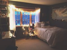 Beautiful room. Lights can completely transform a bedroom from boring to radiant and fun :)