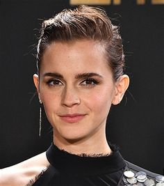 Emma Watson pose at the 2017 MTV Movie And TV Awards at The Shrine Auditorium on May 7, 2017 in Los Angeles, California.