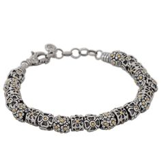Sterling Silver Floral Charm Bracelet with 18K Gold Accents | Cirque Jewels
