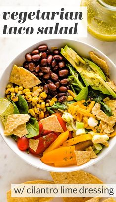 Tacos get a healthy upgrade in the form of a Vegetarian Taco Salad with black beans, a rainbow of veggies, crushed tortilla chips, and a mouth-watering fresh cilantro lime salad dressing. Vegetarian Taco Salad, Taco Salads, Vegetarian Recipes, Lime Salad Dressing, Great Salad Recipes, Easy Family Meals, Family Recipes, Bean Tacos, Quick Weeknight Meals