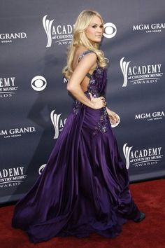 Carrie Underwood in a lovely purple gown on the Red Carpet!