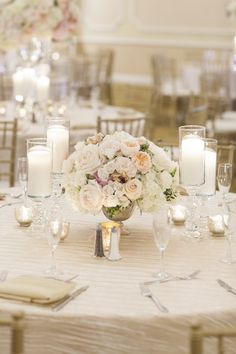 Classic wedding table settings with rose centerpieces
