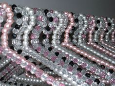 Designer pearl hangers, and crystal hangers.  Beaded clothing hangers.