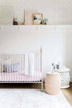 Girls nursery with sweet & subtle details, like the Feather Wallpaper & Bamileke Side Table from #serenaandlily | Image via Studio McGee, Foothill Drive Project