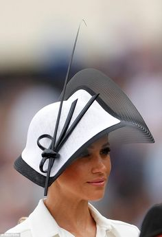 Commenting on Meghan's accessories, Lucas said: 'The details here really elevate this to a cool and contemporary Ascot look while adhering to Ascots rules on dress code. The fascination ads more edge with its structural shaping and absence of anything fussy'