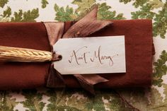 Wooden place card with Calligraphy by Kathryn Murray.
