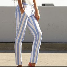"Forever 21 Cream Periwinkle striped pants Forever 21 Cream Periwinkle striped pants,,Small skinny straight pants..A pair of pants featuring a vertical stripe print. Slanted front pockets. Zip fly, hook and button waist. Jetted back pockets. Woven. Unlined. Lightweight. DETAILS: 29"" approx. Inseam, 28"" waist, 11"" leg opening, 7.5"" rise, 22"" thigh girth. Measured from Small. 97% Cotton, 3% spandex. Machine wash cold, line dry. Imported. Forever 21 Pants Skinny"