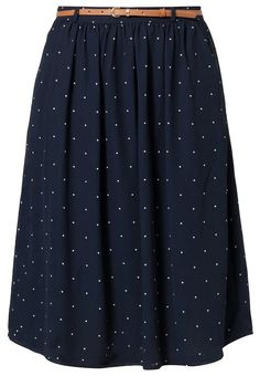 a navy polka dot skirt