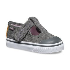 The Glitter Leena, a Mary Jane-styled silhouette, features glitter textile uppers, hook-and-loop closures, vulcanized rubber toecaps, and glittery signature rubber waffle outsoles.