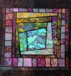 Stained glass quilt made entirely from Batiks. It has vibrancy.