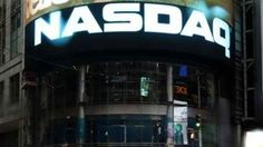 The Nasdaq composite hit a record high on Friday on strong results from Google (GOOGL.O), while the Dow and the S&P 500 fell, dragged down by Boeing (BA.N) and energy stocks.